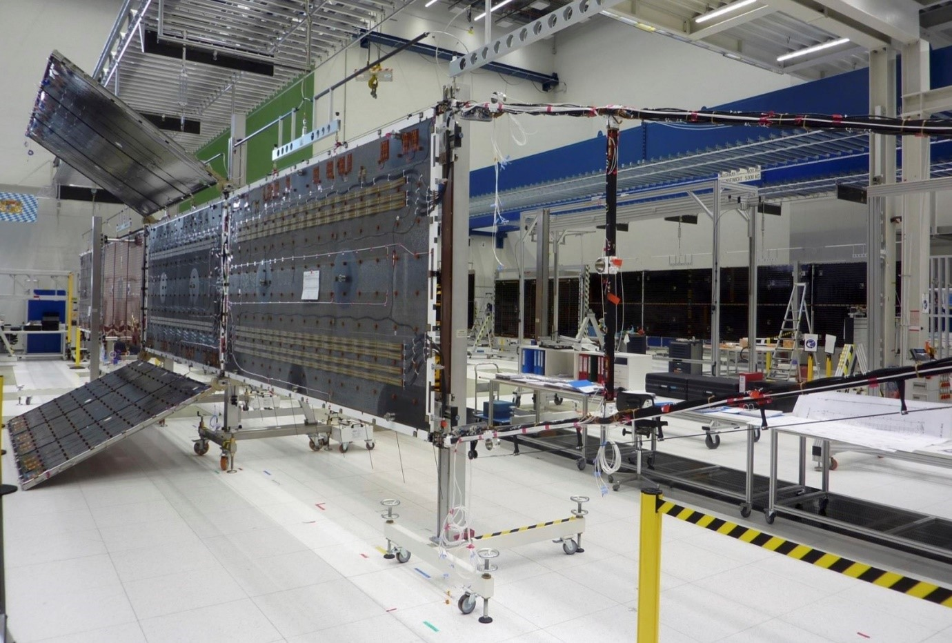 Hybrid Solar Array during deployment testing: the in-line backbone is made up of a conventional solar array, while the lateral panels are lightweight semi-rigid panels (Credit Airbus).