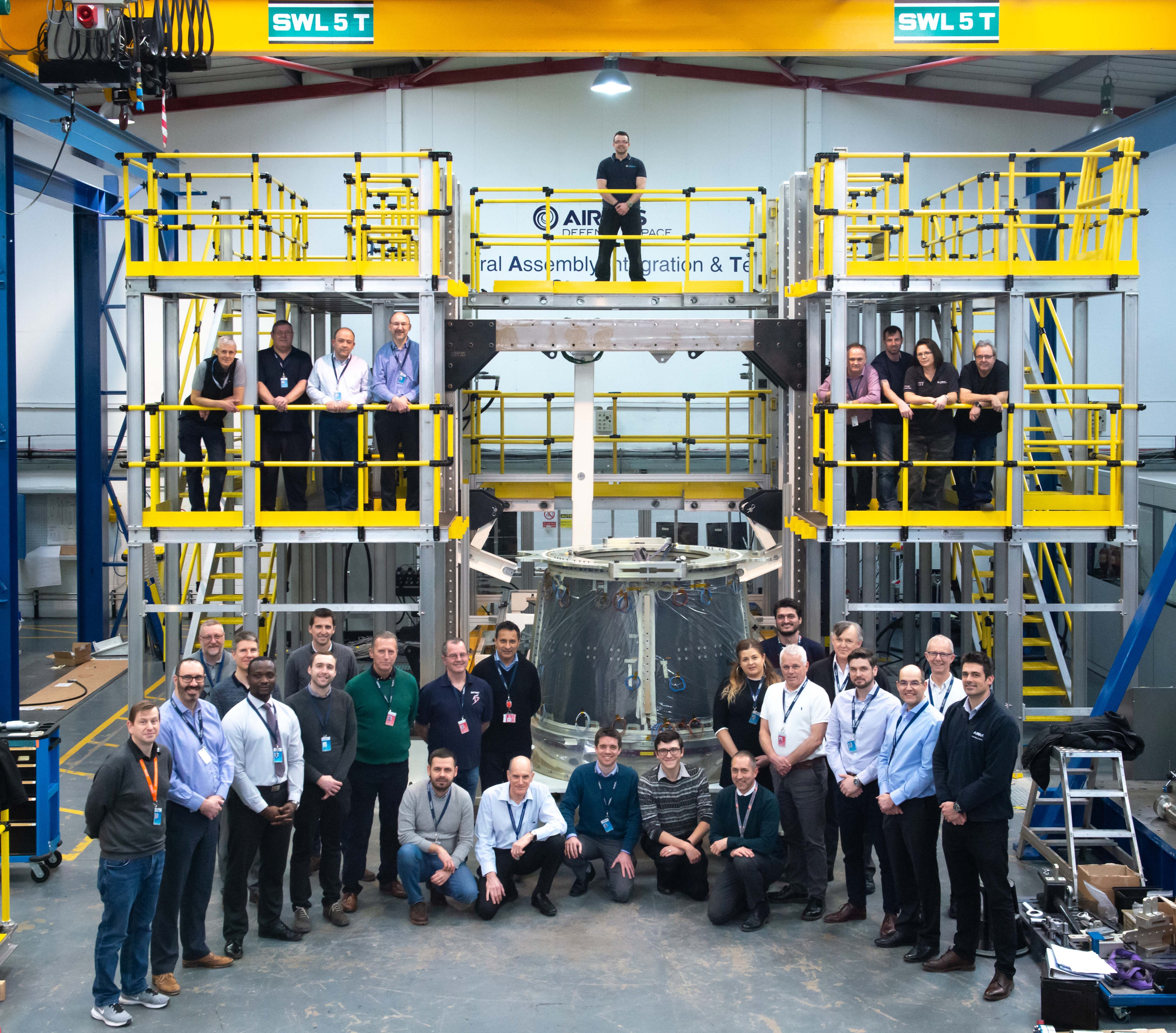 Eurostar Neo central cone with the team at Airbus Defence and Space UK in Stevenage, UK (courtesy of Airbus DS)