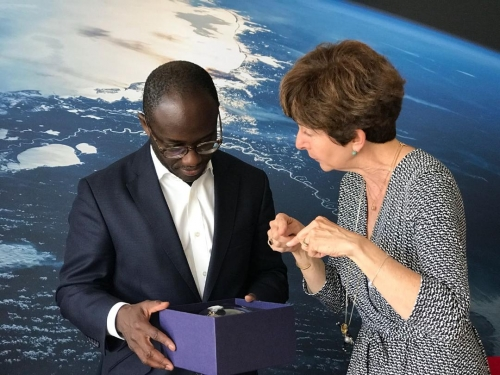 Magali Vaissiere, ESA's Director of Telecommunications  and Integrated Applications, and the UK Science Minister  Sam Gyimah discussing a model of ESA's European Data Relay System at ECSAT