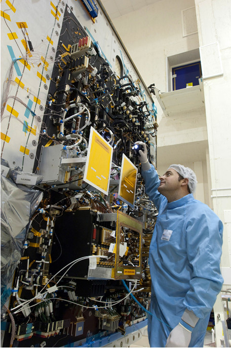 An Airbus engineer inspecting a new spacecraft that incorporates the CAN Bus for Space. Photo credit: Airbus DS